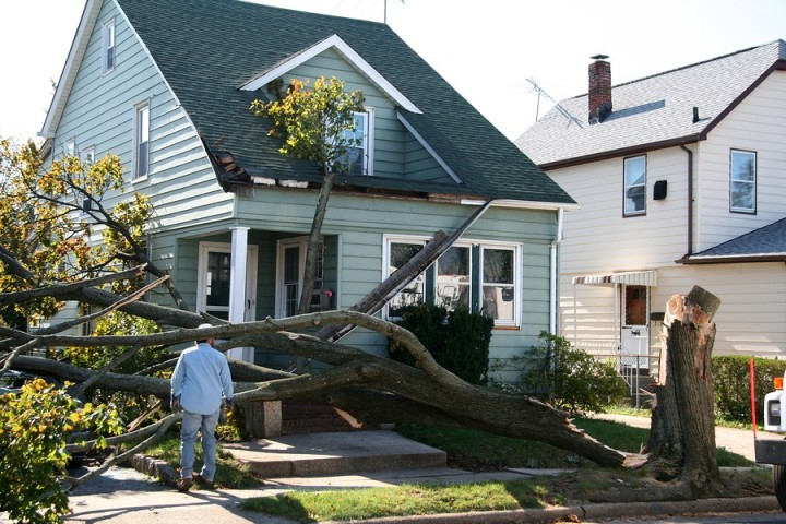 Storm damage to roof by Legacy Construction & Roofing