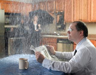 People in need of roof repair in Ford VA. Leaky roof causing it to rain on people in their kitchen. Humorous.